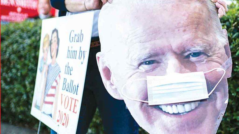 TEXAS Apoiadores fazem campanha em Dallas para apoiar Joe Biden. Previsoes diziam que democrata venceria no Texas, o que não ocorreu
